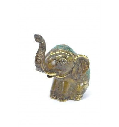 Figurine elephant trunk up in the air. Handmade in bronze.