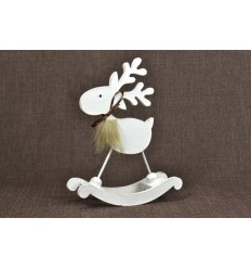 Statuette Reindeer rocking. Christmas decoration in wood.