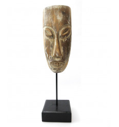 Primitive mask on foot-old style, tribal arts, decorative tribal.