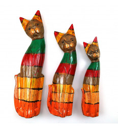 Trio of statuettes of Cats wooden multi-colored, so wood boat that is aged.