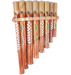 Hand painted and handcrafted bamboo pan flute. Ethnic musical instrument.