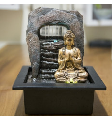 Indoor fountain golden Buddha Zen Dao. Led lighting.